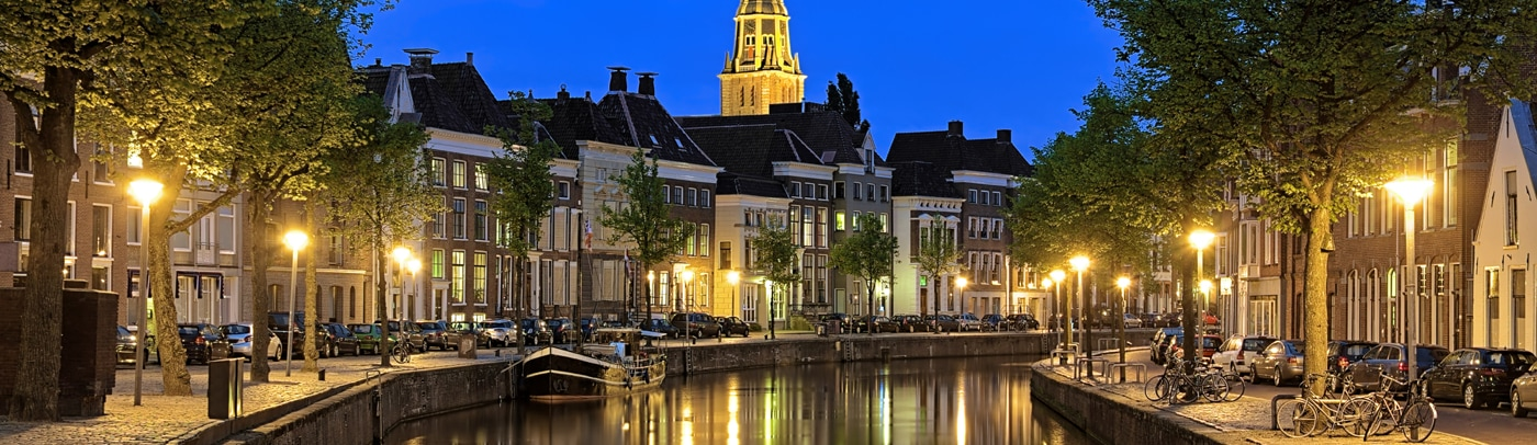 Evening view of Aa river with tower of  A-Church in Groningen, Netherlands